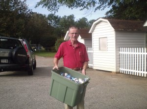 Mr. Carl Brown dropping off recyclables at Gilmore Center